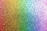 Fototapeta Tęcza - Composition of sparkling rainbow glitter as background, top view