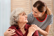 Elderly Woman With Female Caregiver At Home