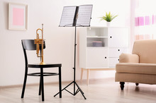 Trumpet, Chair And Note Stand ...