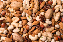 Organic Mixed Nuts As Backgrou...