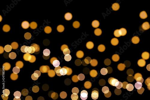 Fototapeta Beautiful golden lights on dark background. Bokeh effect obraz na płótnie