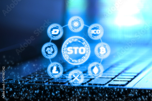 Fotografía  3D Rendering of Security Token Offering (STO) and digital binary numbers overlay on blur notebook and keyboard