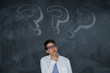 young teenager on the blackboard with question mark