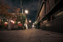 Traditional Japanese Buildings At Night In Autumn On A Narrow Street In Gion District, Kyoto, Japan.