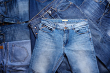 A Heap Of Jeans. Texture Background.