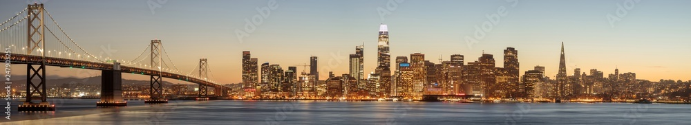 Fototapeta The Bay Bridge and San Francisco Skyline Panorama. Views from Yerba Buena Island on a clear winter evening..