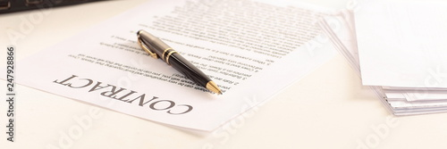 Photo  signed contract on the desktop. business background