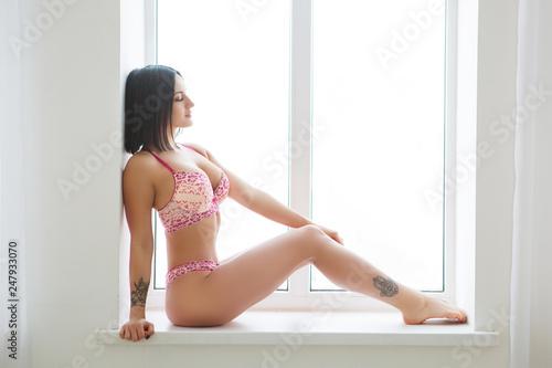 Fotografie, Obraz  Sexy brunette beauty posing at the window