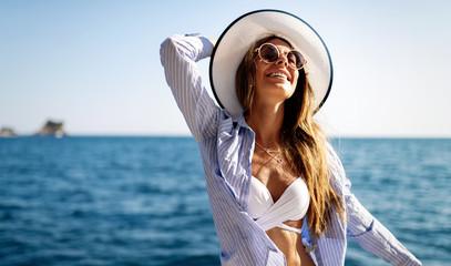 Young sexy woman in bikini enjoying summer vacation on beach