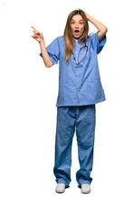 Full Body Young Nurse Pointing...