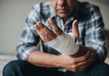 Man With A Gauze Bandage Wrapp...