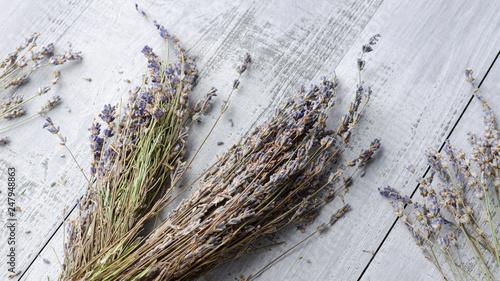 Valokuva  dry natural lavender flowers over wooden background