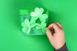 Leinwanddruck Bild - DIY leprechaun trap with gold coins, rainbow and green ladder St Patricks Day background.