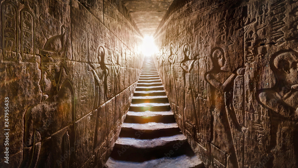 Fototapety, obrazy: ABYDOS EGYPT Sethi I temple, completed by Ramses II (-1200). Passage flanked by two glowing walls full of Egyptian hieroglyphs, illuminated by a warm orange backlight from a door at the