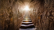 EGYPT Edfu, Aswan Temple, Completed By Ramses II (-1200). Passage Flanked By Two Glowing Walls Full Of Egyptian Hieroglyphs, Illuminated By A Warm Orange Backlight From A Door At The