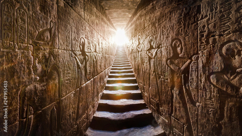 Printed kitchen splashbacks Place of worship Temple of Edfu, Egypt. Passage flanked by two glowing walls full of Egyptian hieroglyphs, illuminated by a warm orange backlight from a door at the end of the stairs.
