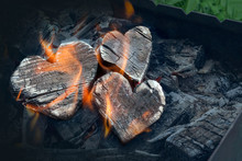 Hot Coals And Burning Woods In The Form Of Human Heart. Glowing And Flaming Charcoal, Bright Red Fire And Ash. .Close-up, Top View. Space For Text Input