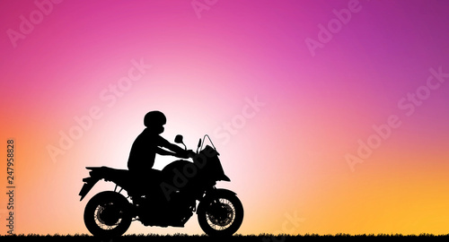 Tuinposter Roze Silhouette biker with his motorbike beside the natural lake and beautiful sunset sky.