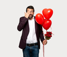 Man In Valentine Day Covering Eyes By Hands. Surprised To See What Is Ahead Over Isolated Grey Background