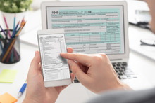 Man Filling Tax Information Using Mobile Devices