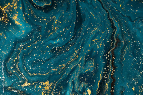 Abstract paint texture art. Natural luxury. Blue paint with gold glitter powder. Marble background. - 247971497