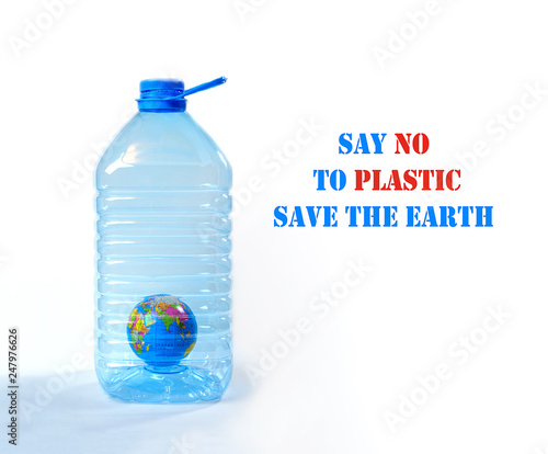 Creative layout for World Environment Day - Plastic Free. The globe as symbol of the Eearth inside big plastic bottle. Concept of saving the environment, pollution. Copy space for text. Close up