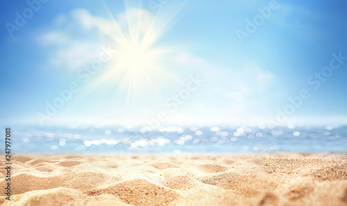 Cadres-photo bureau Beige Summer background, nature of tropical golden beach with rays of sun light. Golden sand beach, sea water against blue sky with white clouds. Copy space, summer vacation concept.