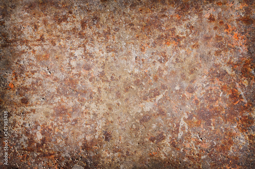 Fotografie, Obraz  Corroded and rusty background surface with vignetted lighting