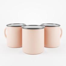 Three Beige Enamel Metal Mugs ...