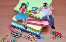 Collage Of Photos Boy And Girl Colorful Sheets Of Paper And Paper Clips