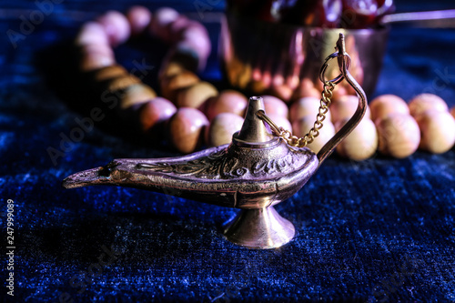Photo Aladdin lamp of wishes on color table