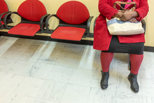 Health Care: View Of Feets Of A Woman In Red In Doctor's Waiting Room