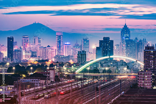 Poster Light pink Cityscape and railway station at evening time. Shenzhen. China.
