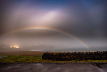 Very Rare Moonbow During The Night Above Staffin Bay - Isle Of Skye, Scotland