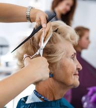 Closeup Of Senior Woman Getting Haircut