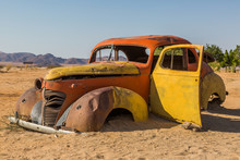 Abandoned Vehicle Wrecks In The Desert Of Namibia, Africa