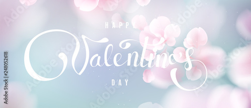 фотография  Happy Valentine's day soft color pastel background with flower petals and lettering