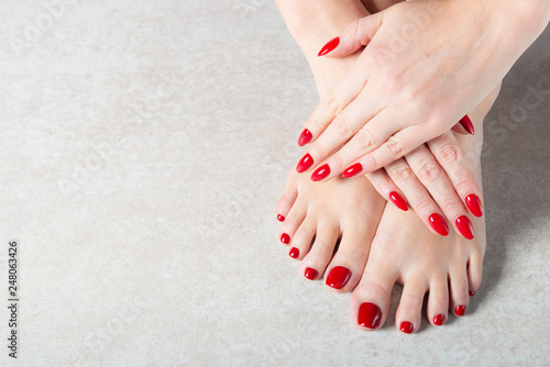 Valokuva Young lady is showing her red manicure nails
