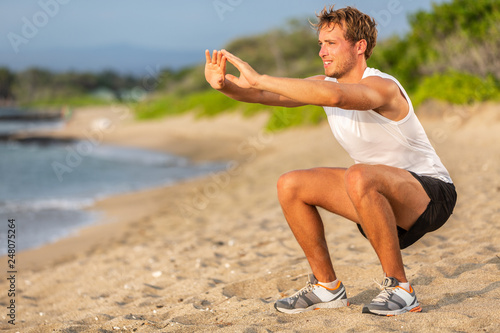 Fotografie, Obraz  Fitness workout fit man strength training doing squats on beach