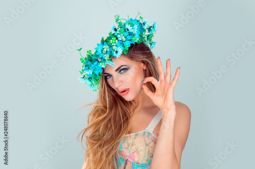 Photographie  Attractive young adult Woman with floral headband showing ok sign