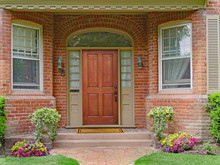 Brick House With Recessed Entrance And Elegant Wooden Front Door