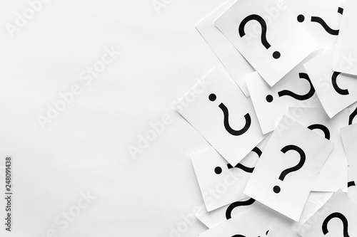 Photo Pile of question marks printed on white cards