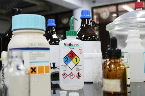 Fotografie, Tablou  Bottle of Methanol and chemical with hazard symbols for experiment in Laboratory
