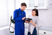 Pest Control Worker Showing Invoice To Woman