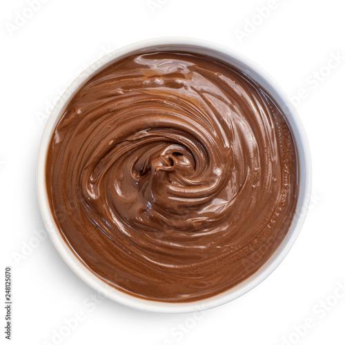 Fototapeta  Chocolate hazelnut cream in white bowl, isolated on white