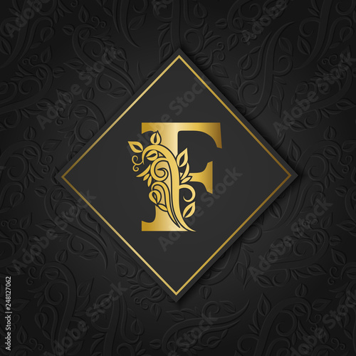 Foto  Golden letter F with elegant floral contour isolated on colorful separate background