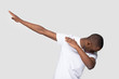 canvas print picture - Happy black man making dab gesture on blank studio background