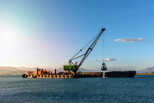 Industrial Ship That Digs Sand Making Harbor Deeper For Bigger Ships To Be Able To Dock