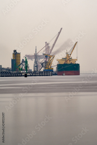 Photo  Containership being unloaded at the Port of Amsterdam by cranes