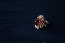 Golden Ring With Red Stone Iso...